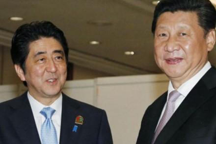 Shinzo Abe and Xi Jingping meet.