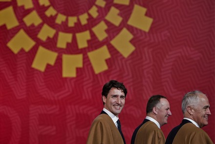 Canada's Prime Minister Justin Trudeau (L), New Zealand's Prime Minister John Key (C) and Australia's Prime Minister Malcolm Turnbull at the Asia-Pacific Economic Cooperation (APEC) Summit at the Lima Convention Centre in Lima on November 20, 2016.  |  Brendan Smialowski/AFP/Getty Images