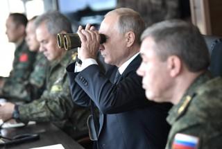 Image of President Putin using binoculars